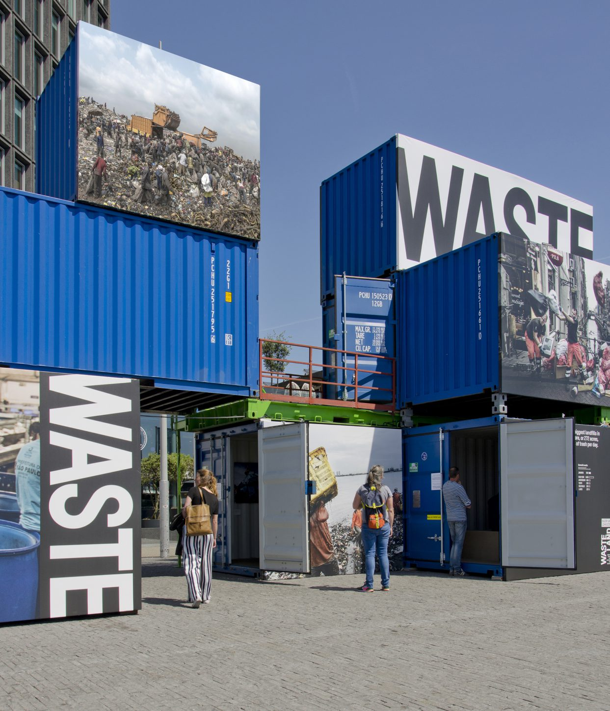 Shipping containers stacked up three stories high at the outdoor exhibition Wasteland, Kadir van Lohuizen