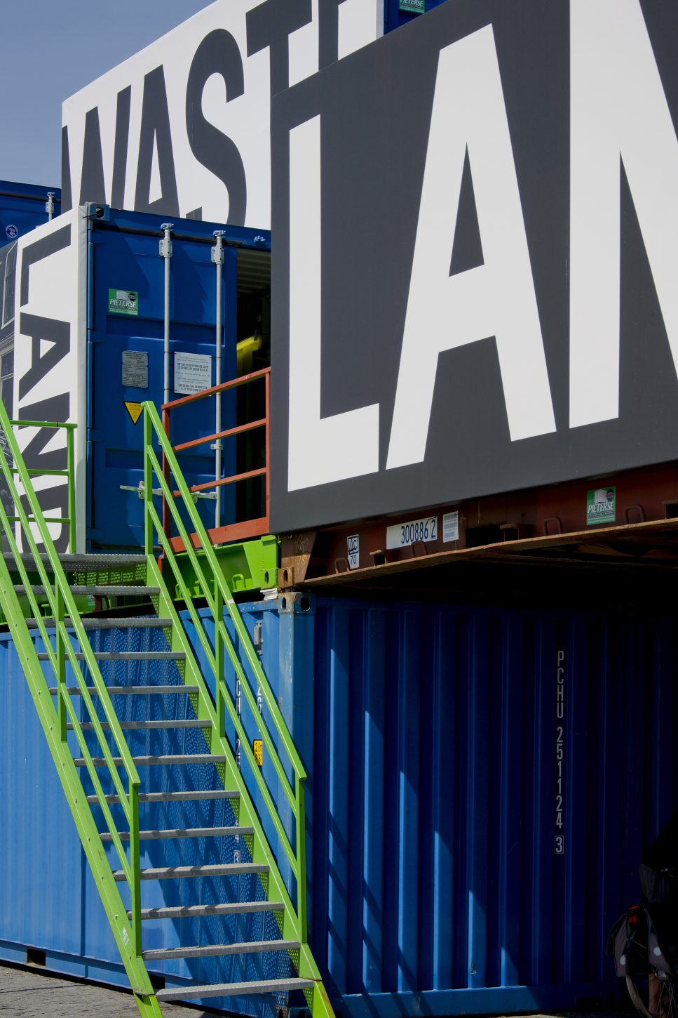 Close up of typography applied on shipping containers at the outdoor exhibition Wasteland, Kadir van Lohuizen